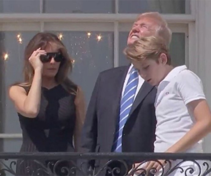 Donald Trump looks directly at the sun during the eclipse and we're just like WTF?