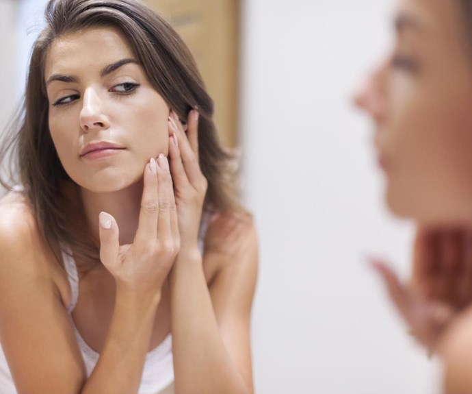 Woman popping pimples