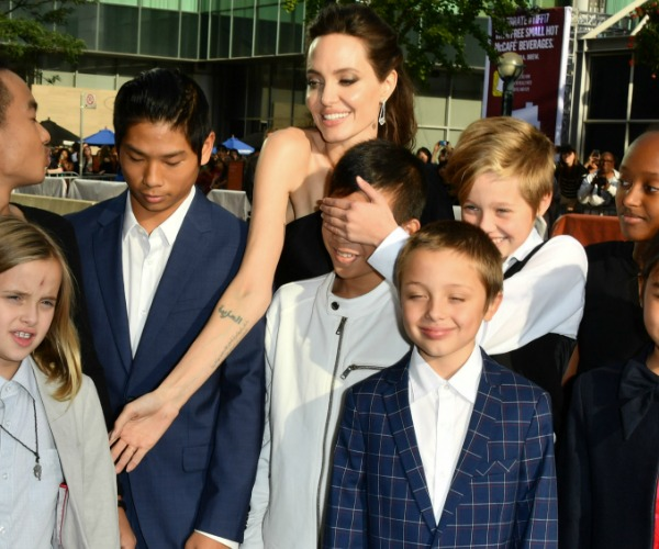 And just like that the Jolie-Pitt's prove they're just like any other family! Well sort
