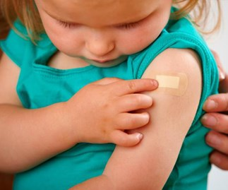 Little girl after her measles shot