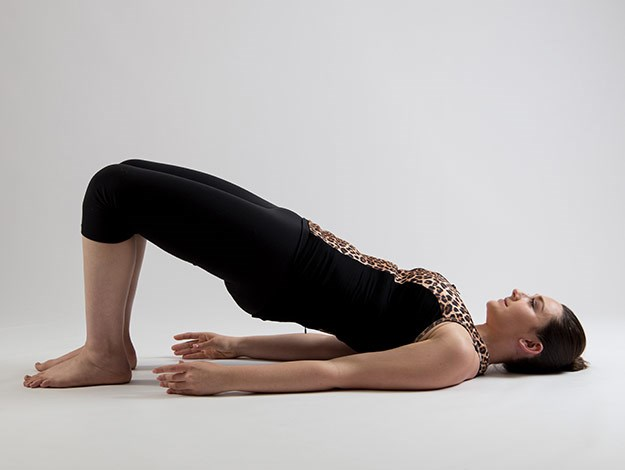 Bridging  Areas targeted: Bottom and backs of the legs Perform 8-10 times  1. Lay down on your mat with your legs bent and the feet hip distanced apart.  2. Inhale to prepare and as you exhale roll your hips towards you flattening your lower back into the mat and continue to peel through the spine until you are in a bridge position. You want to have a nice line from the knees to the shoulders.  3. Inhale at the top and as you exhale begin to roll down through the spine back to the start position. Make sure you have your tummy tight throughout the whole movement and you are squeezing your bottom for the best results!