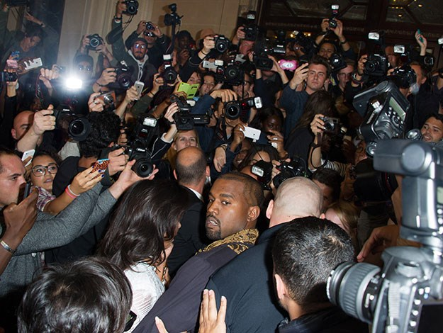 Kimye face the huge surging crowd.