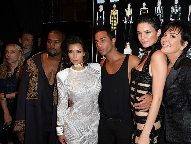 Kim and Kanye were at the fashion show along with mother Kris Jenner to support Kim's sister Kendall Jenner make her Paris Fashion week debut as she walked the runway in a barely-there dress for the uber-posh French label Balmain.