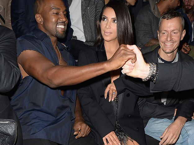 Kim and Kanye sit front row at another show - there's clearly too much fashion to enjoy to let the attack get them down!