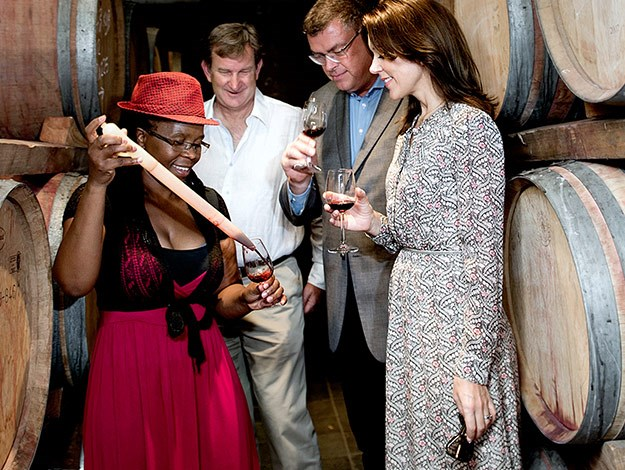Princess Mary enjoys a glass of red wine from the winery known for producing the best red wine in Cape Town.