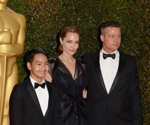 Angelina Jolie, Maddox Jolie-Pitt and Brad Pitt
