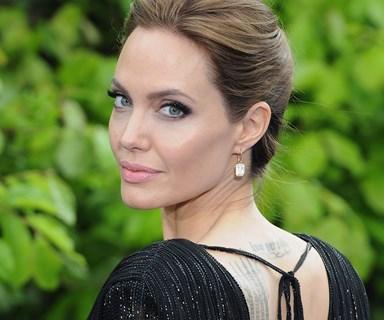 "OUCH! ""I was tattooed by Angelina Jolie's Thai guru!"""