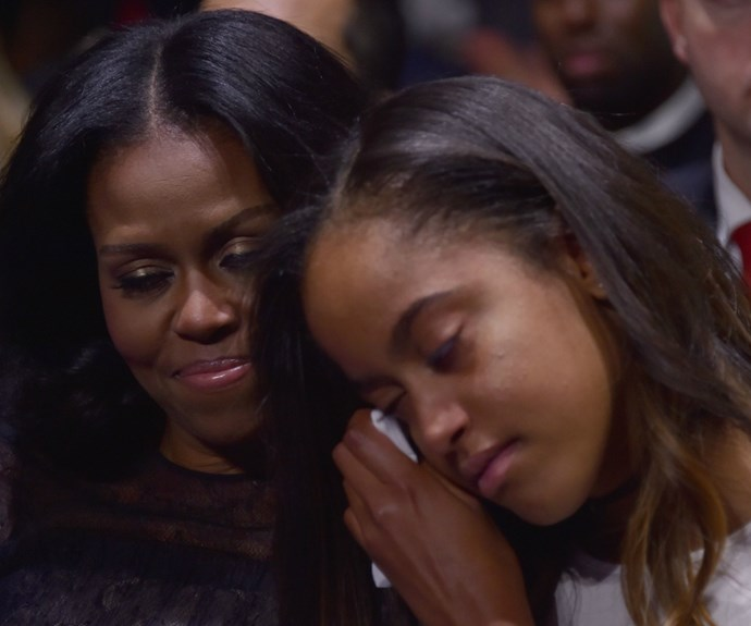 Malia's head resting upon her adoring mum's is no doubt an image that will go down in history.