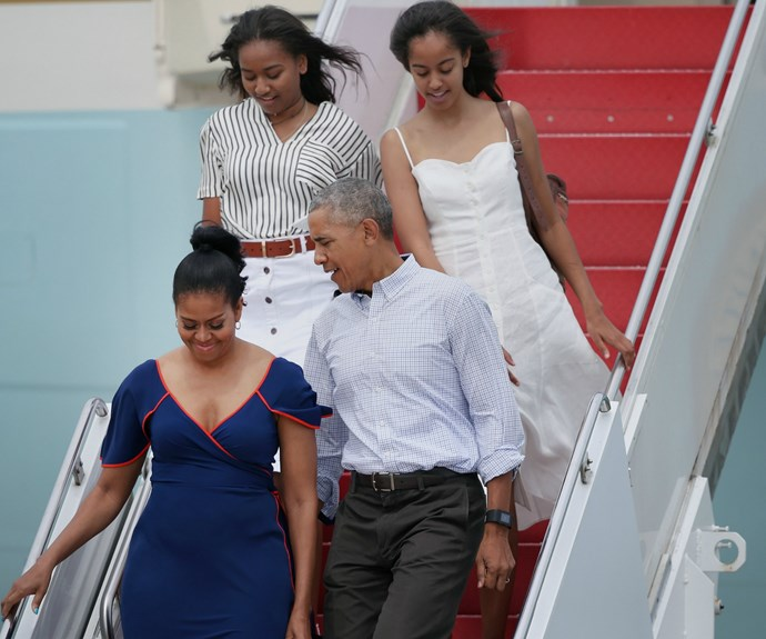 Here the family can be seen on vacation in 2016. Sasha (L) and Malia (R) are led down the stairs of their private jet by adoring parents Michelle and Barack.