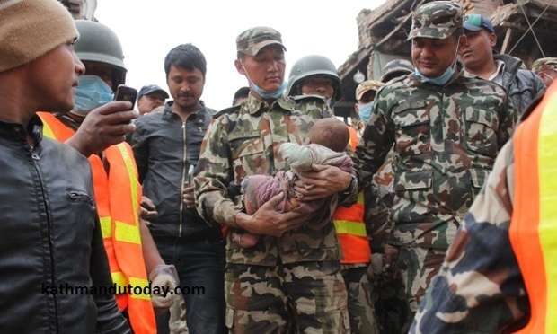 Baby boy trapped in Nepal earthquake rubble pulled out alive after 22 hours.:
