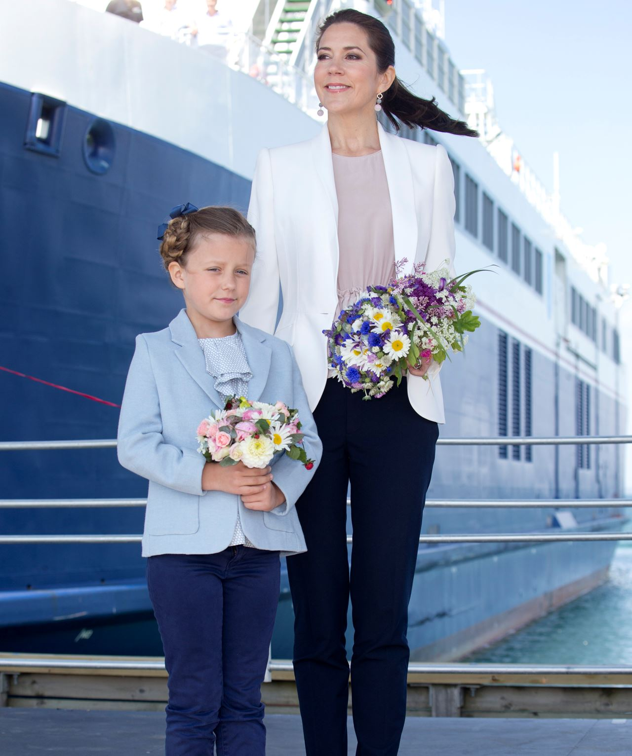 Like mother, like daughter:Posing with posies with her mother, Tasmanian-born Princess Mary.