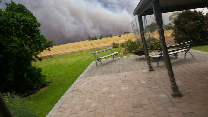 The wall of smoke, minutes before the flames reached the home.