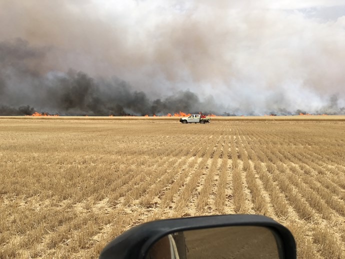 A view from the ute of the fire approaching.