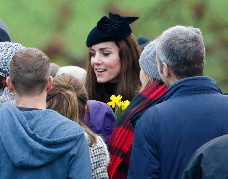 Prince William Shelters Kate Middleton with Umbrella on Walk to Christmas Service