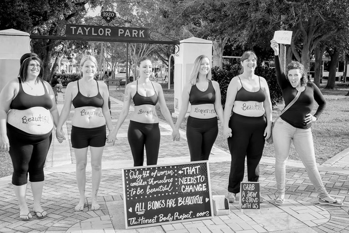 """""""The women in this photo are brave. They are inspirational. They stood on the corner of a crowded street and told the world they were beautiful and others took a stand with them."""" - via The Honest Body Project.   NATALIE MCCAIN/HONEST BODY PROJECT"""