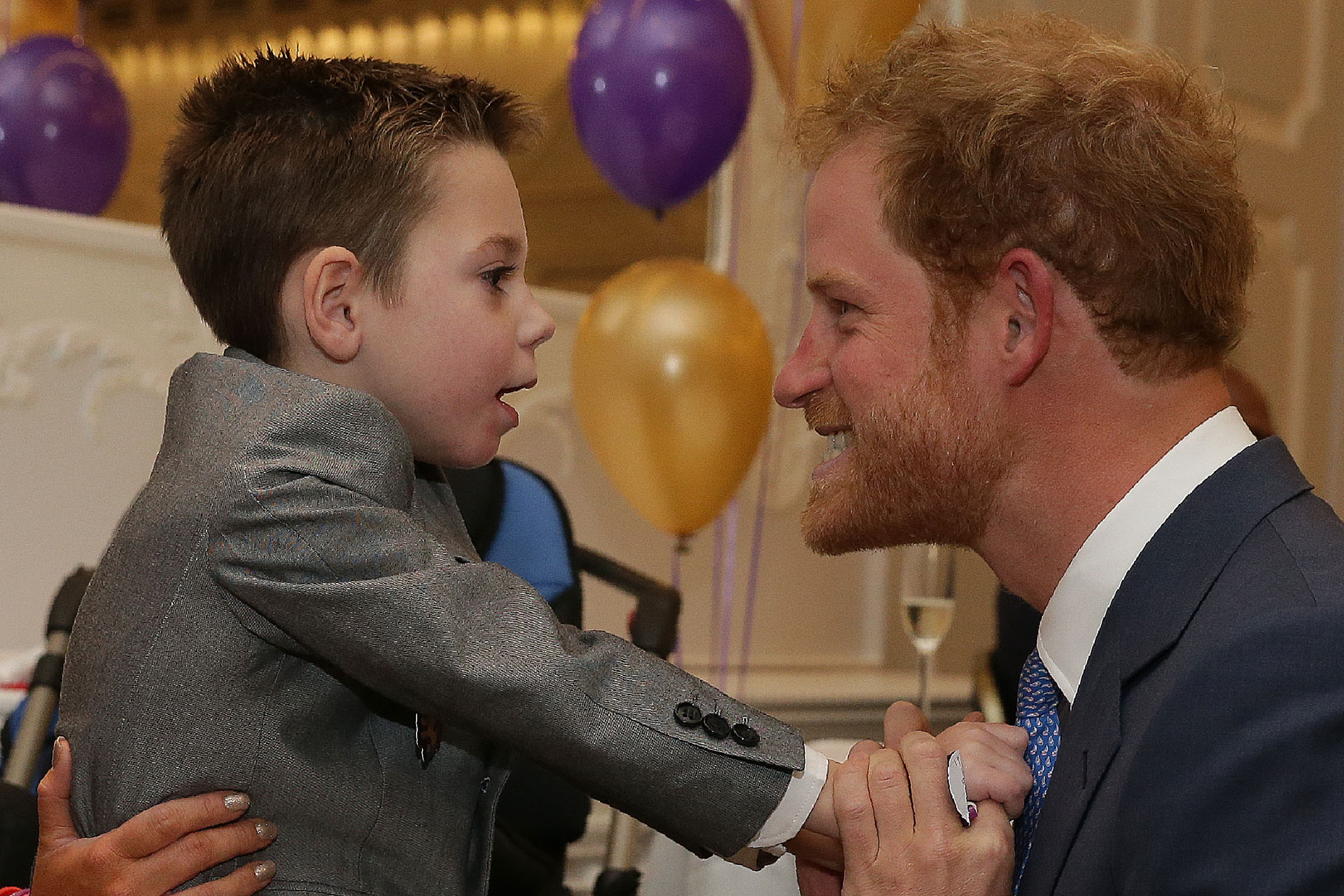 Prince Harry is hugged at WellChild Award ceremony