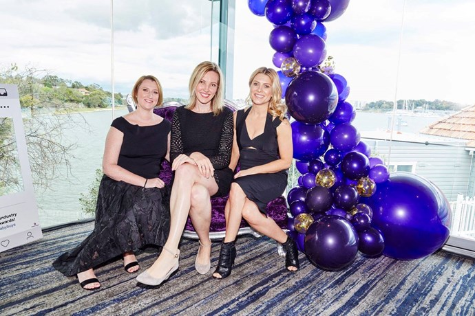 *Mother & Baby* magazine editors Erin Mayo and Fiona Wright with Awards host Natalie Bassingthwaighte (and the stunning view from the Sydney Rowing Club).