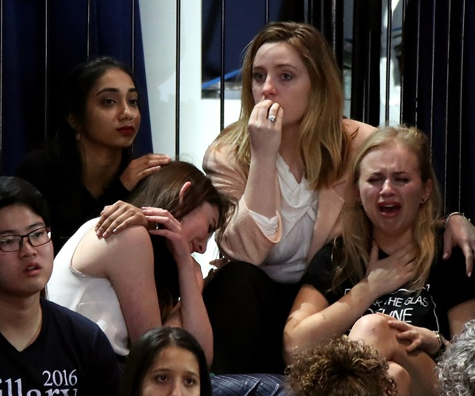 Devastated Hillary Clinton supporters watch the election results roll in New York City.