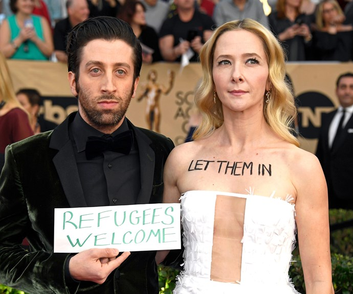 *The Big Bang Theory* star Simon Helberg and wife Jocelyn Towne protest Trump's new refugee policy.