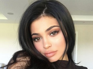 Kylie Jenner shares selfies wearing fishnet tights in bed