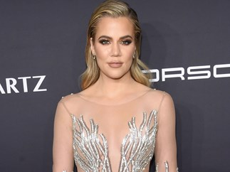 So, Khloé Kardashian is burning off her freckles and moles