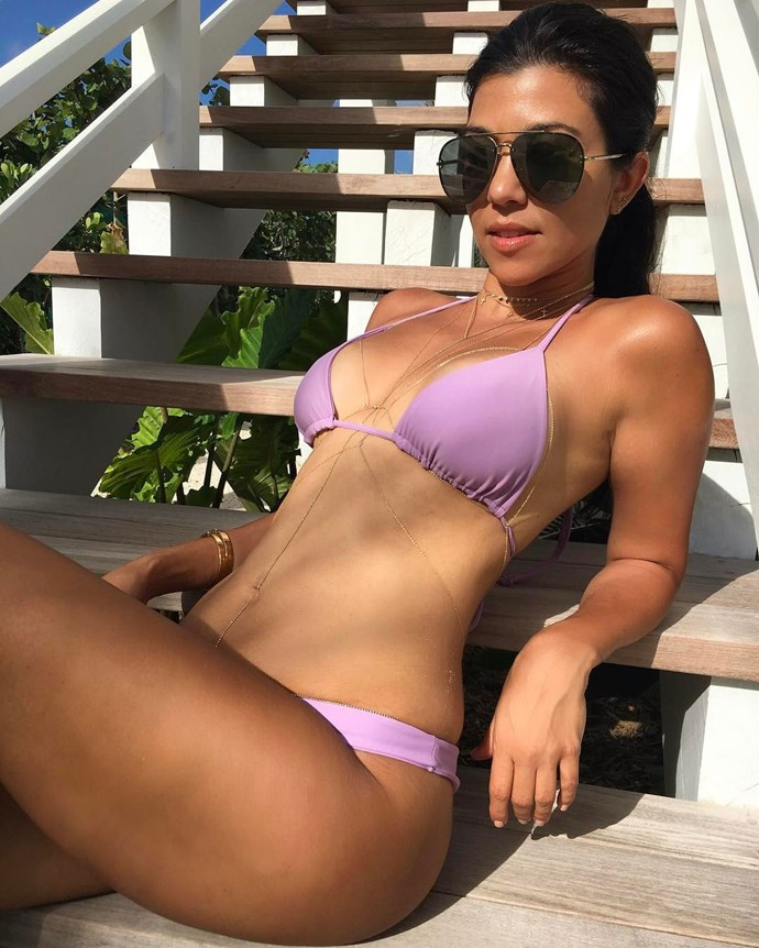 Kourtney Kardashian looks like actual FIRE in her latest bikini snap, finished with a gold body chain ('cause why the eff not?).