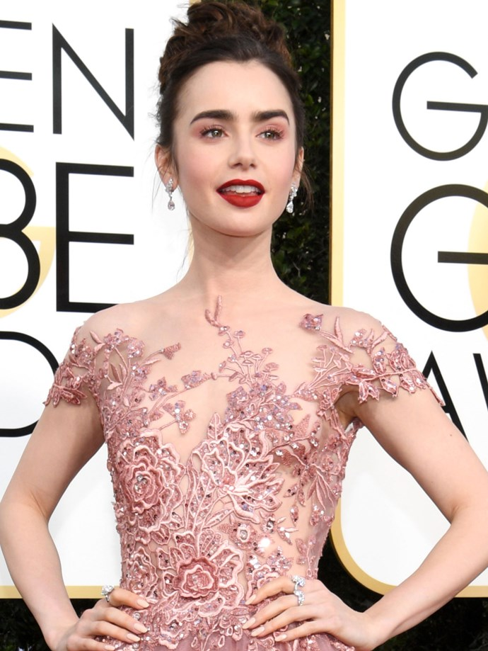 Lily Collins' look is glamour meets vampire.