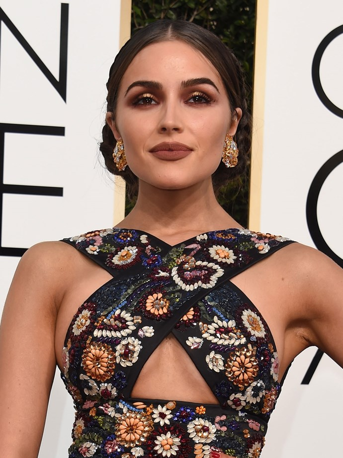 The bronze smokey eye! The bold brown lip! The braids! Safe to say, Olivia Culpo nailed it.