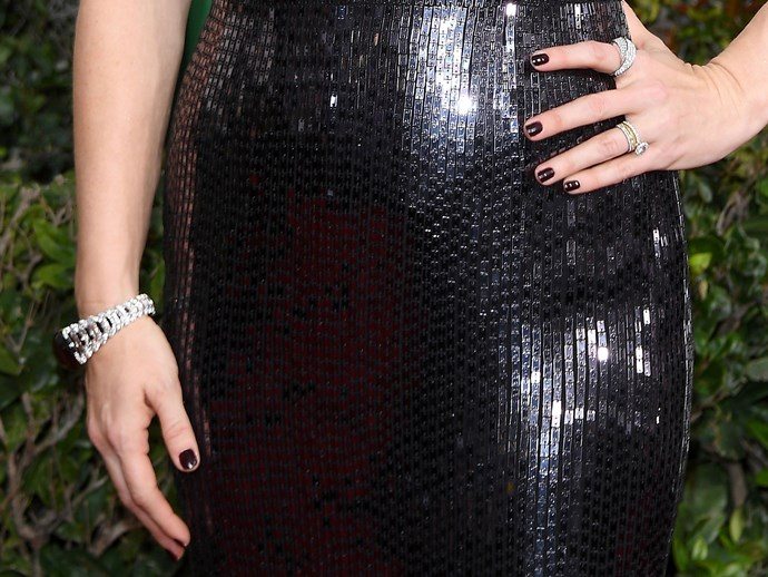 **Amy Adams** <br>  How many topcoats did that take?! Girl goes for high-gloss black on black and it's totally working.