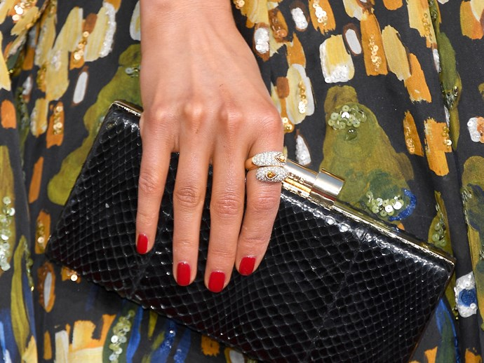 **Olivia Culpo** <br>  A classic square nail, glammed-up in fire-engine red and set against a pattern is timeless.