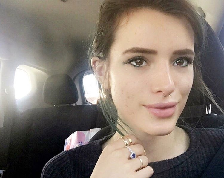 """Bella Thorne: When she on Instagram, """"Real skin alert 🚨 it's no secret I struggle w acne. Sometimes it's clear and sometimes it's just not. I'm very self conscious and constantly feeling bad about myself. BUT I shouldn't feel bad. It is normal to have acne. EVERY1 does! It's only our society and social media outlets like this one that tells us we have to have """"perfect skin"""" to be considered socially acceptable. I'm here to tell you rn FUCK THAT. I'm going to show my skin for what is it and own it. No matter what any1 says. #ownit #beyou #acne #purebeauty #nofilter #lol"""""""
