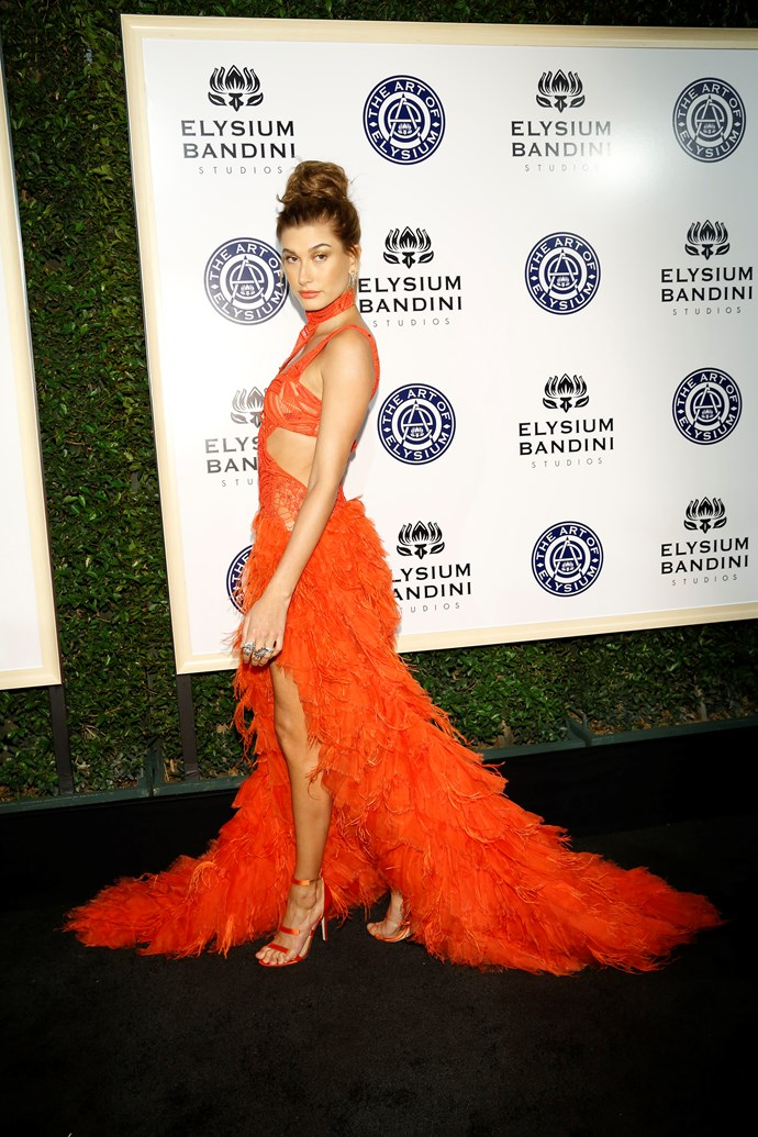 Hailey Baldwin goes to town in a tangerine feather bonanza that only Hailey B can pull off.