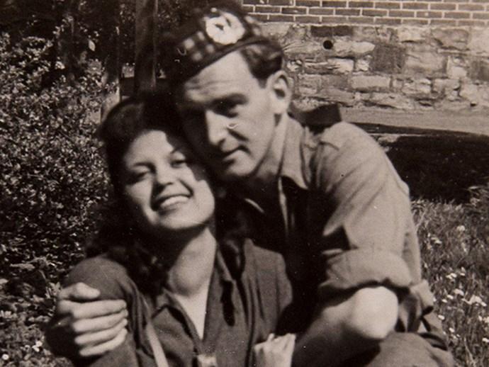 Auschwitz survivor hugging husband