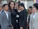 Angelina Jolie makes first official appearance since split from Brad Pitt – with all six of her kids