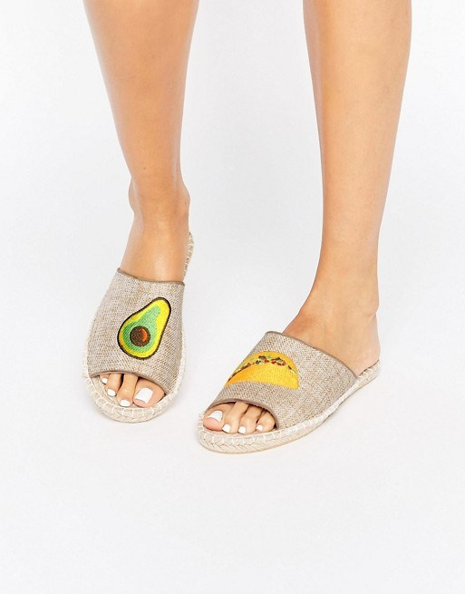 """Look, we'll be the first to admit we love a cute novelty shoe, but I'm sorry. In NO planet does this [espadrille/mule monstrosity](http://www.asos.com/asos/asos-jalapeno-avo-taco-espadrille-mules/prd/7202867 target=""""_blank"""" rel=""""nofollow""""), adorned with a GINORMOUS avo and taco on the front classify as 'cute'."""