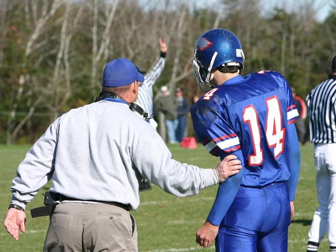 Football coach.