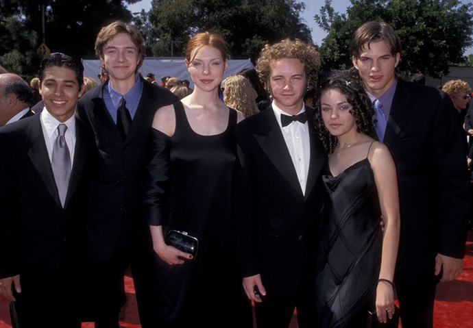 **Ashton Kutcher and Mila Kunis**  At the Emmy Awards in September 1998. (Yes, we realise they weren't together, and it's with the rest of the cast from *That '70s Show*.)