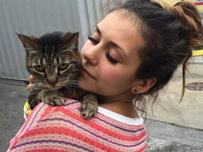 Nina Dobrev and cat.