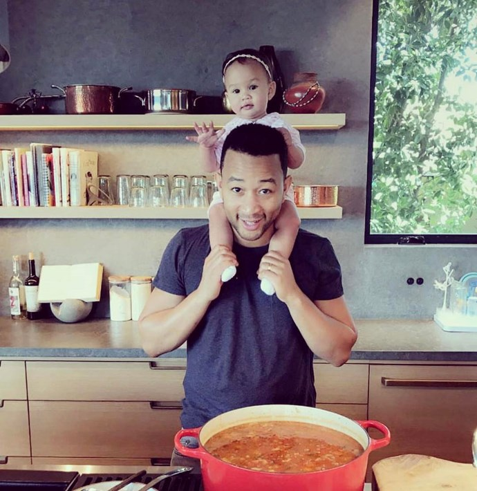 Helping her dad cook!