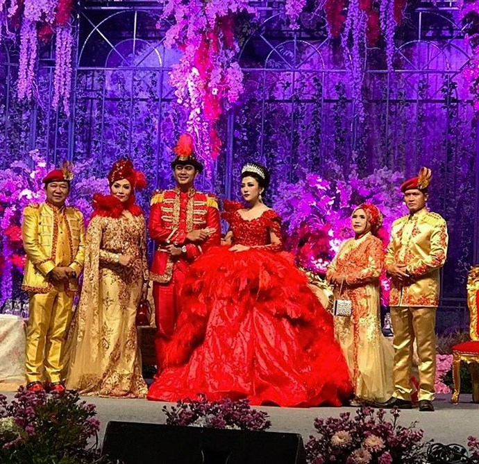As if that weren't enough, it was the bride's second gown that truly stole the show. Since her guests dressed in red and gold, it was only polite that the bride and groom do, too. Right? Here are the results.