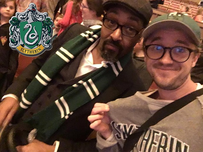 **Tom Felton** showed his Slytherin pride at a live musical screening of *Harry Potter And The Chamber Of Secrets* in Vancouver this week. (Nice of him to convert his *The Flash* co-star, Jesse L. Martin, too!)