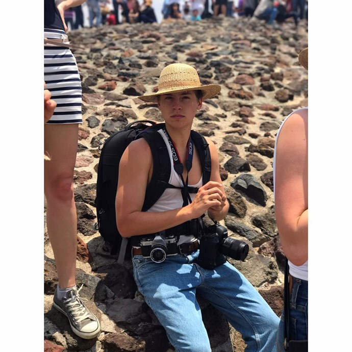 Cole Sprouse, looking like one helluva hipster tourist. Dat hat tho.