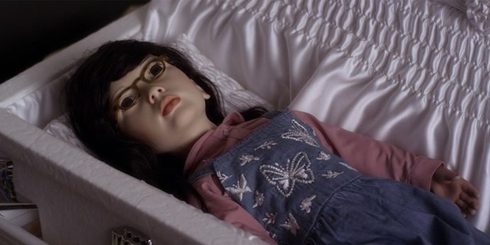 **Mona in a coffin**  Reminder that this was an actual coffin for children, and this doll must be around the size of a four-year-old.