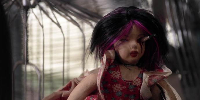 **Knife in the eye**  Because dolls aren't creepy enough *before* they get stabbed through the face.
