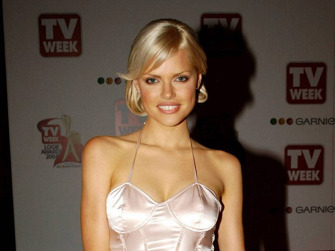 **Side Fringes**  This really makes us miss flicking out the edge of our razored side fringes with a straightener. TBH, still want to do this look.   *Sophie Monk, 2004*