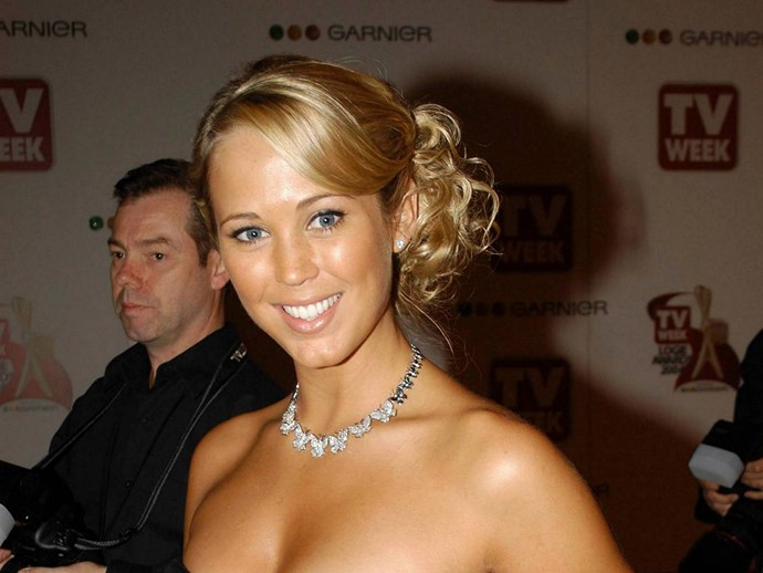 **Side Fringes**  Bec's is a little more curvy, and sweeps into a tendril-y side bun of course.   *Bec Hewitt 2004.*