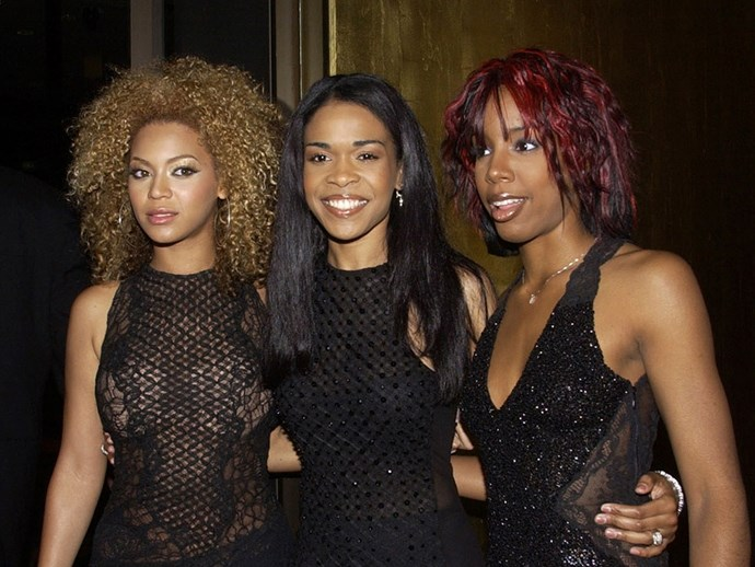 **Coloured Hair**  Colourful hair crimped, was amaze. Destiny's Child coming down under, also amaze.   *Beyonce Knowles, Michelle Williams and Kelly Rowland, 2002.*