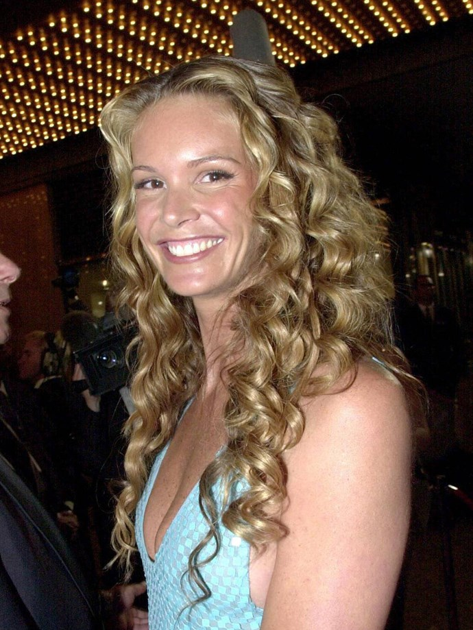 **Tendrils**  Can we bring Elle's tendril curls back asap? Undone waves are so much effort.   *Elle Macpherson, 2000.*
