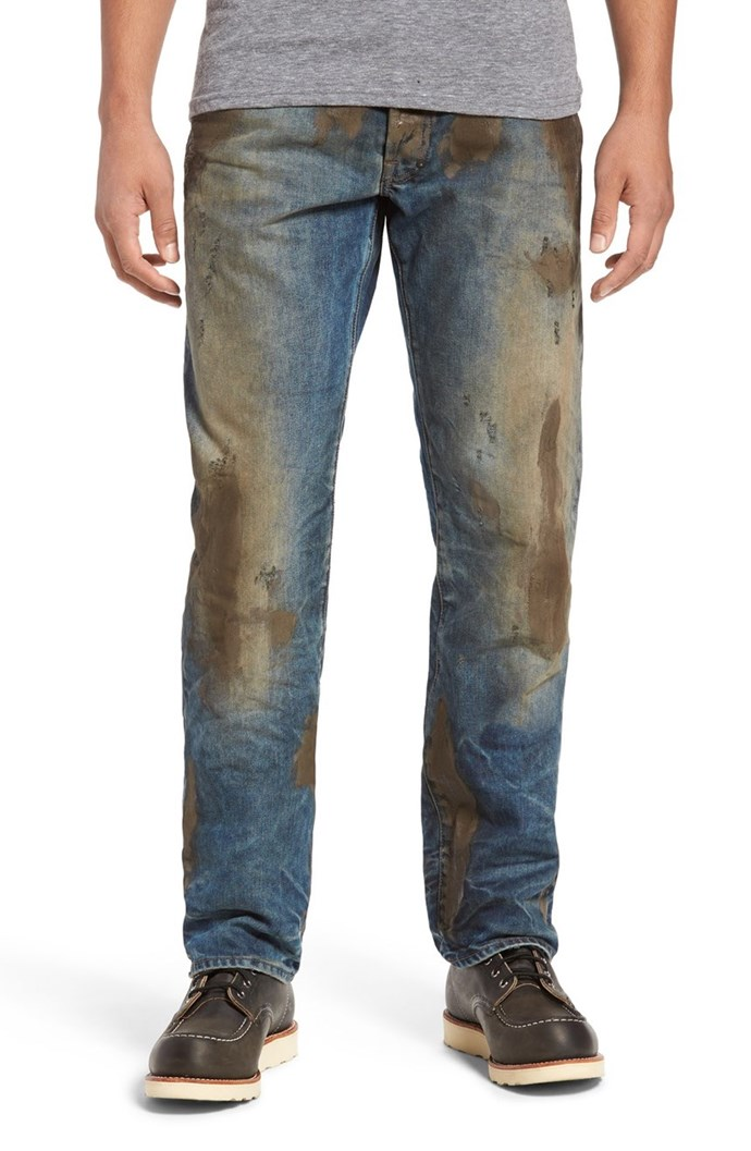"""Okay, get this: Nordstrom have gone and made an equally-cray pair of [jeans](http://shop.nordstrom.com/s/prps-barracuda-straight-leg-jeans/4457245?cm_mmc=Linkshare-_-partner-_-10-_-1&siteId=TnL5HPStwNw-tKurOf1p0ifnY3Ga69jfKg target=""""_blank"""" rel=""""nofollow""""), covered in fucktonnes of fake mud. The most shocking part? They cost almost $600 😱. Seriously, we'd pay $600 to *not* wear this monstrosity."""