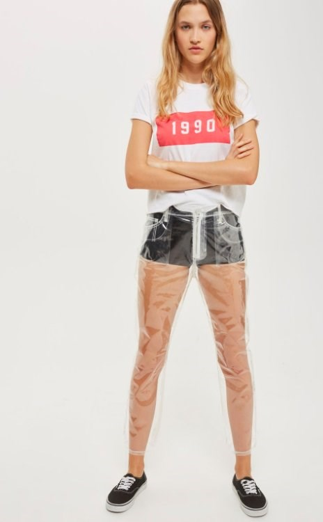 """[Topshop](https://au.topshop.com/ target=""""_blank"""" rel=""""nofollow"""") have taken their god-awful 'window' panel jeans to a whole other level by deciding to ditch the denim all together. The result? 100% see-through plastic pants. Y THO?!"""